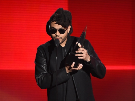LOS ANGELES, CA - NOVEMBER 22: Singer The Weeknd accepts Favorite Soul/R&B Album for 'Beauty Behind the Madness' onstage during the 2015 American Music Awards at Microsoft Theater on November 22, 2015 in Los Angeles, California. (Photo by Kevin Winter/Getty Images)